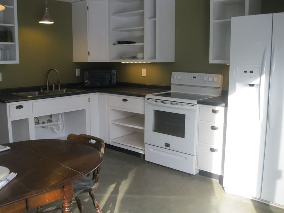 Full kitchen with new appliances, dishes and cookware to serve four.