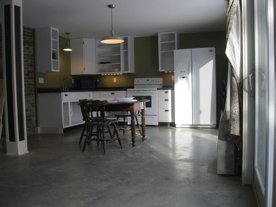 Dine-in kitchen open to living room of equal size. Both spaces receive light from two sets of 6' sliding doors!