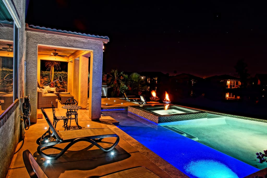Concrete LED lighting surrounds the pool