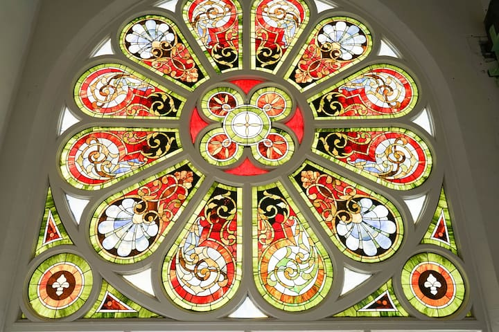 Breathtaking view of our beautiful stained glass windows in the lobby!