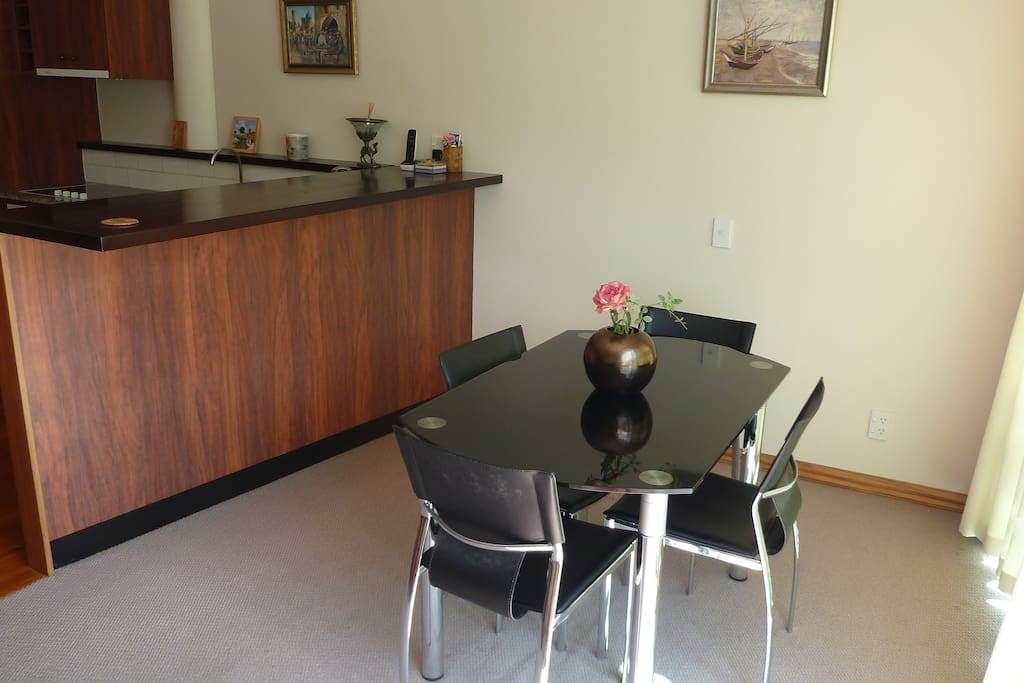 Dining table extends to circle to seat 4.
