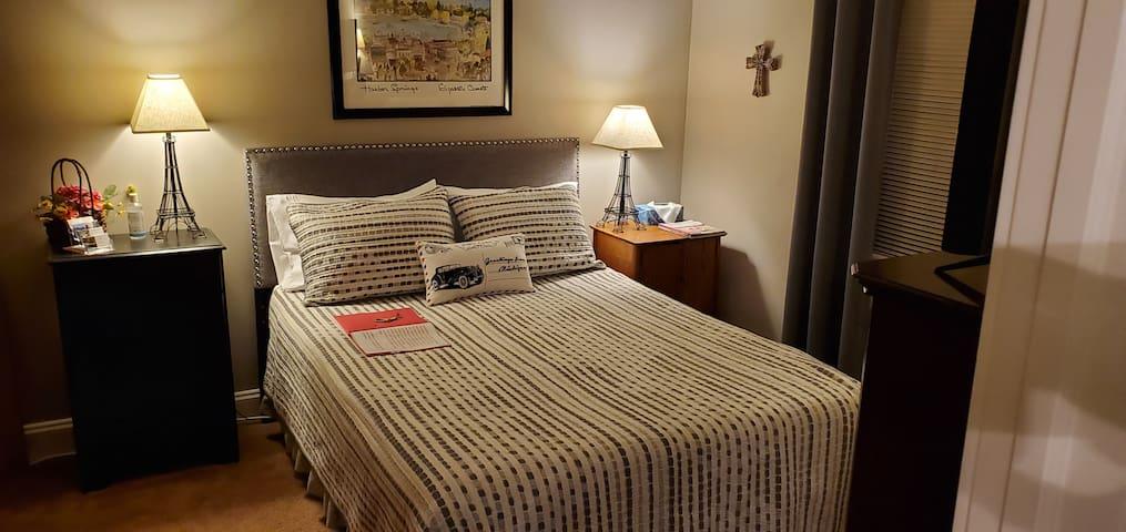 First floor bedroom with queen bed