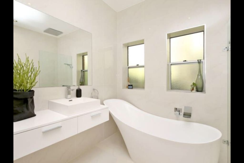 Beautiful bathroom with monsoon shower and bath