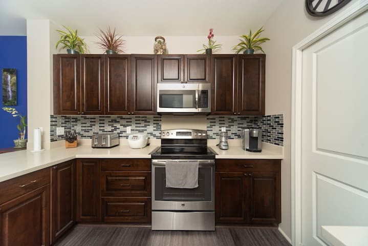 Beautiful kitchen with high quality appliances and essential tools