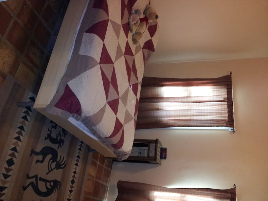 Double bed in front bedroom has new mattress, pillows, and linen.