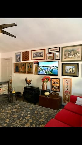 Living area with gas logs and TV on the wall.