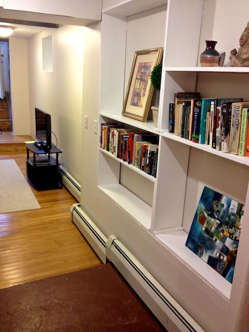 Hall of books to peruse while staying at the apartment. Flat screen TV & WiFi internet access.