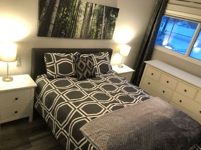 Master Bedroom #1 comes complete with a luxurious queen size bed, 3 large windows with window coverings bringing in tons of light, large walk-in closet, ceiling fan with remote and large dresser!