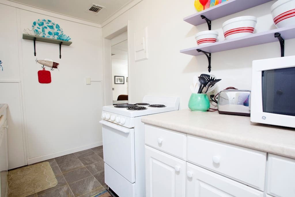 Full kitchen with dishwasher, stove and refrigerator. Stocked with all utensils and cookware.