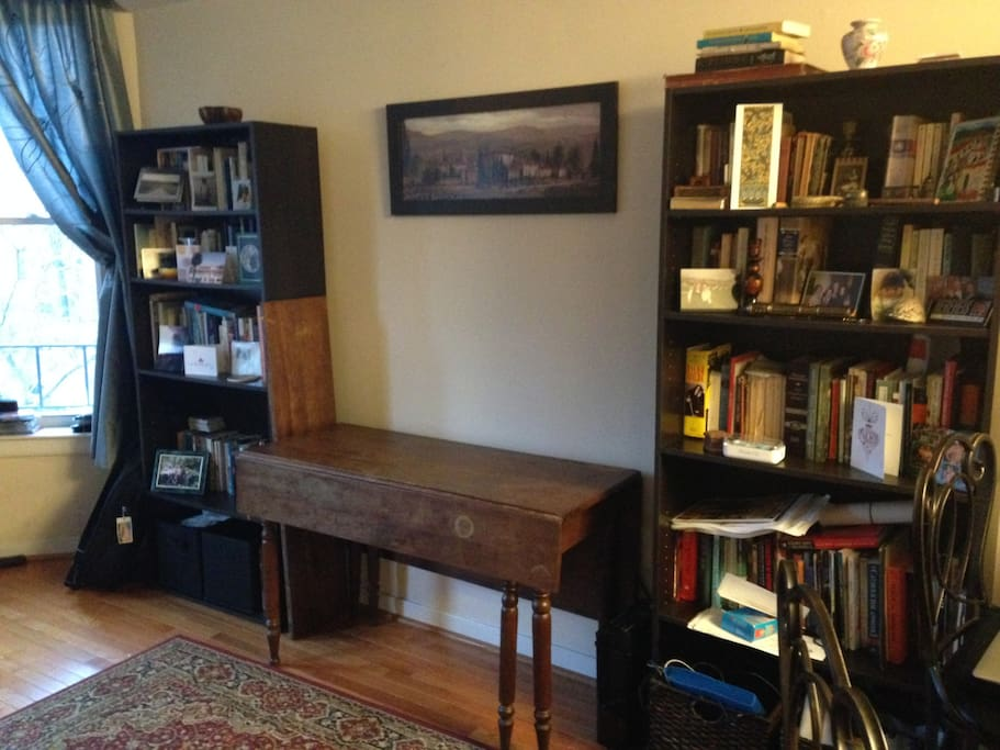 Browse an extensive library. Table folds out for dining or work.