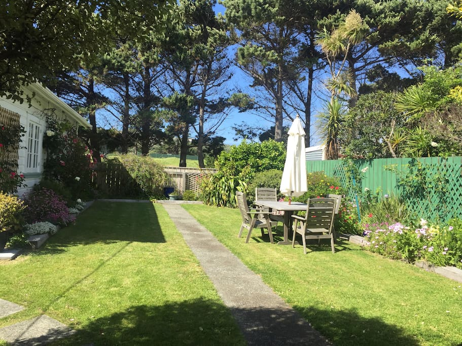 We back onto the popular Miramar Links Golf Course. Our garden attracts birds, including tui.