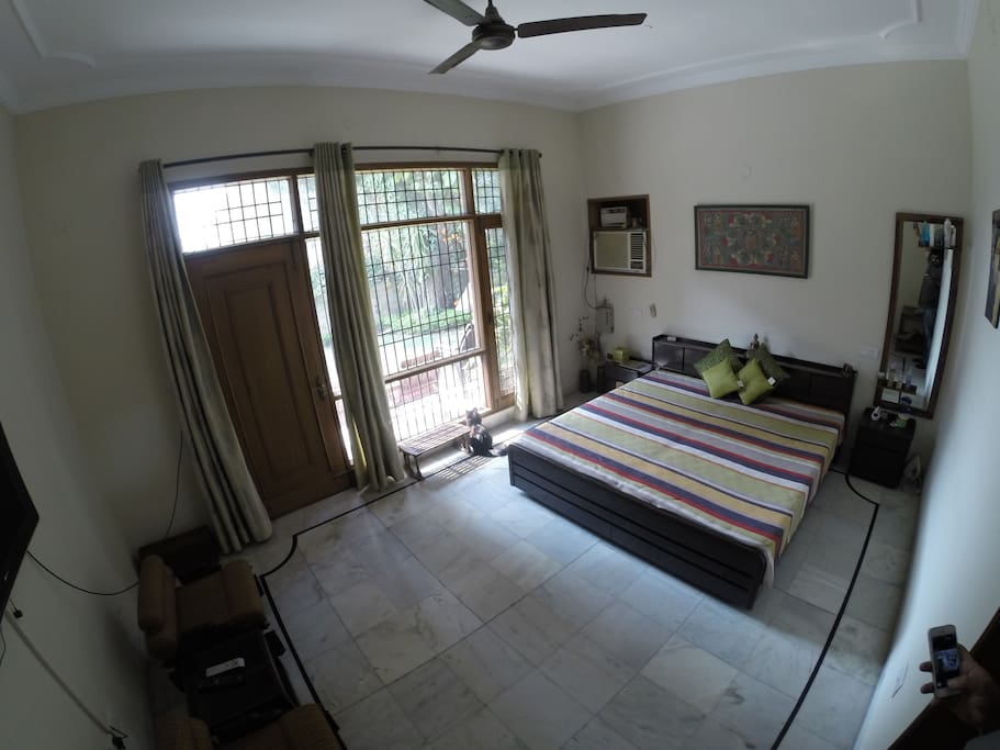 Your Private air conditioned Bedroom. Full length mirror, Huge windows