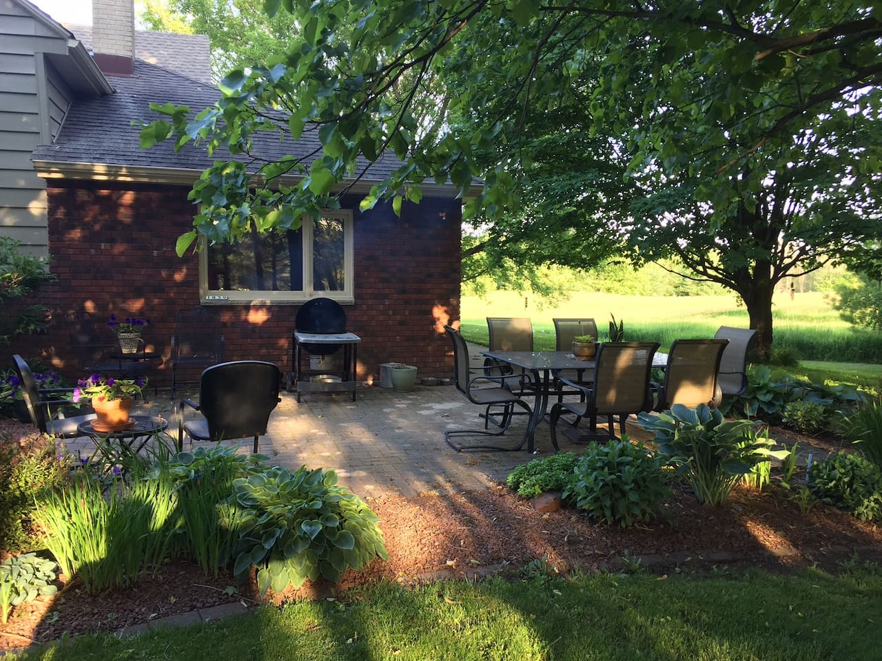 Beautiful, relaxing brick patio with dining and sitting areas