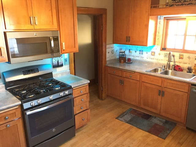 Fully stocked kitchen with new appliances.
