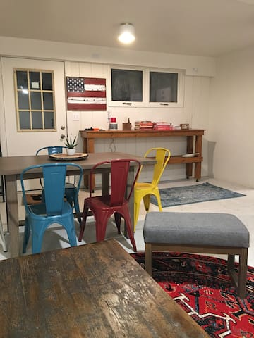 dining room table, pony bar with board games and message board