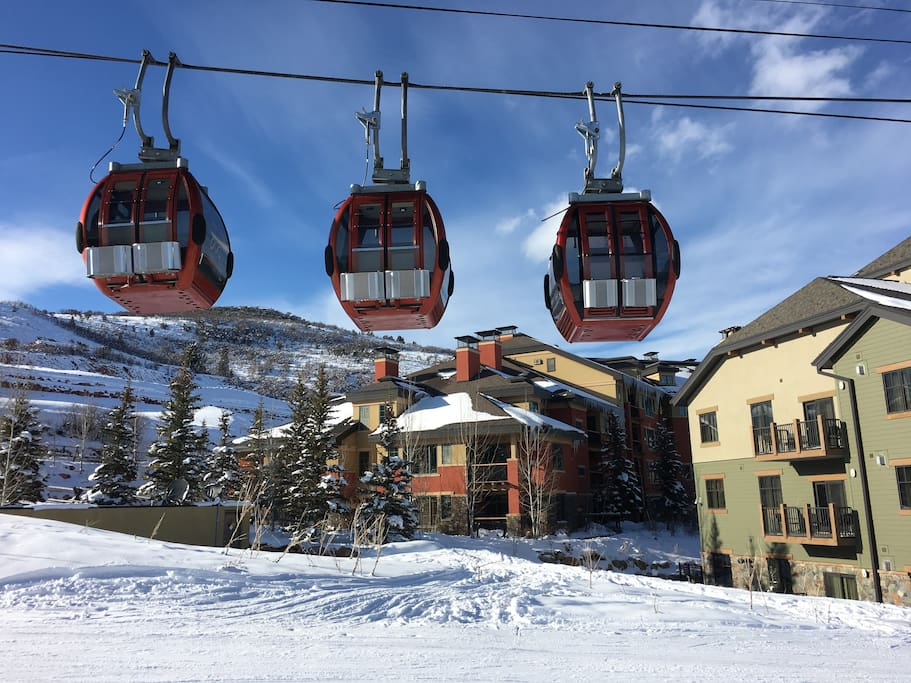 enjoy a premier ski in ski out location -- gondola and slope in foreground, property in directly behind