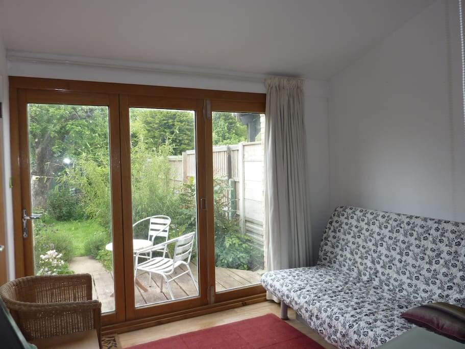 Garden and Sitting Room with TV.  Comfortable sofa bed folds out king size.