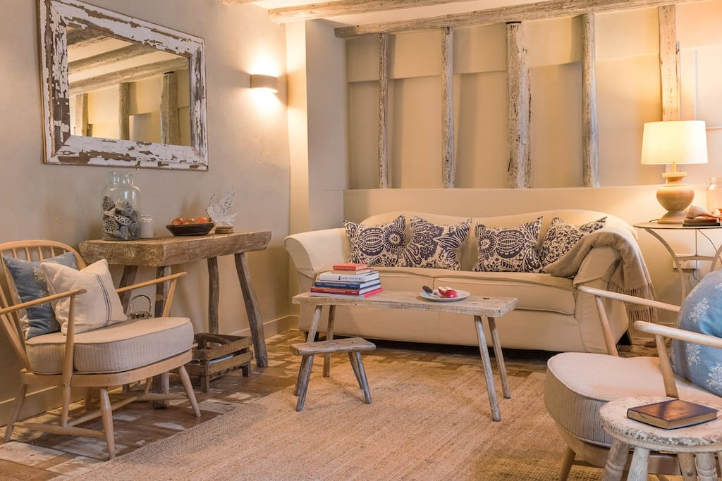 Living Room with pale washed beams and comfy sofa etc