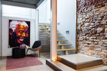 A South African artist's impression of Madiba creates a unique focal point for the downstairs area.