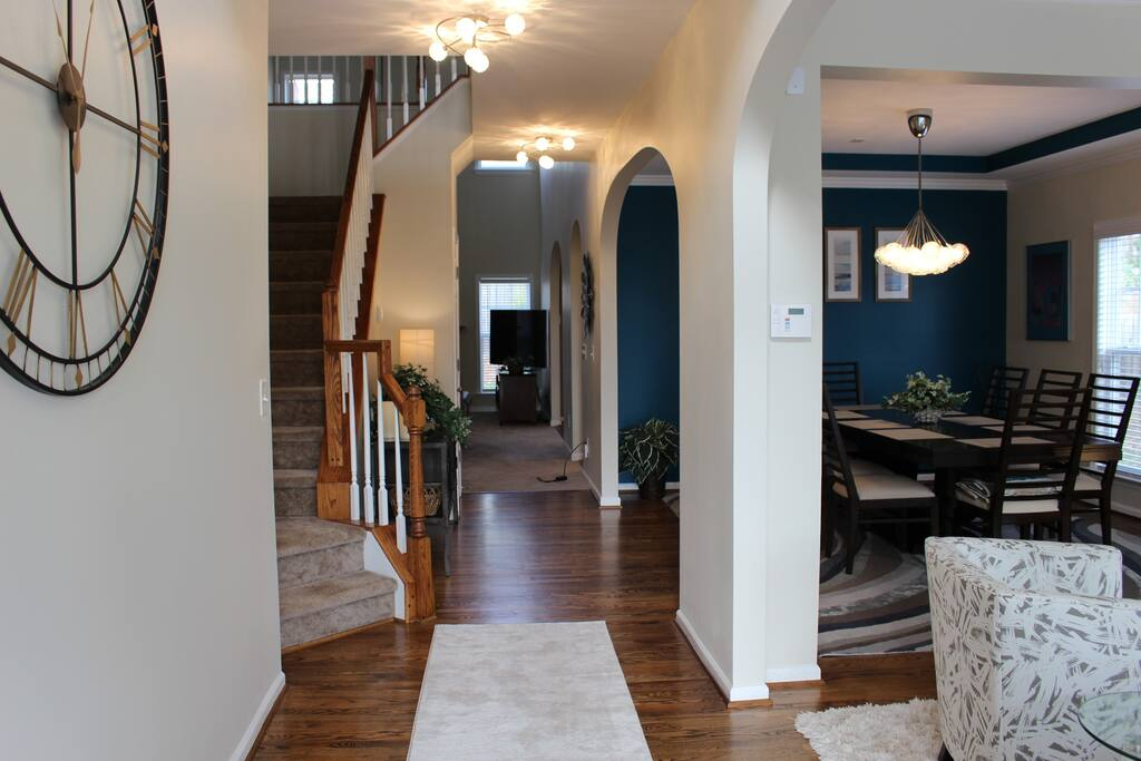 Walk in the front door into the foyer, living room and dining room.