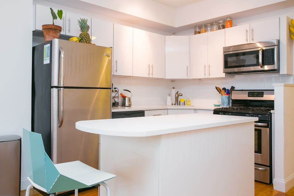 Brand new fully equipped kitchen with stainless steel appliances including a dishwasher.