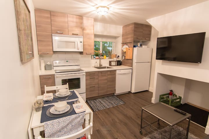 Full kitchen and dining for two with pull-out TV