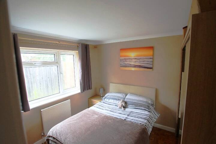 Master Bedroom with double bed, TV and wardrobes