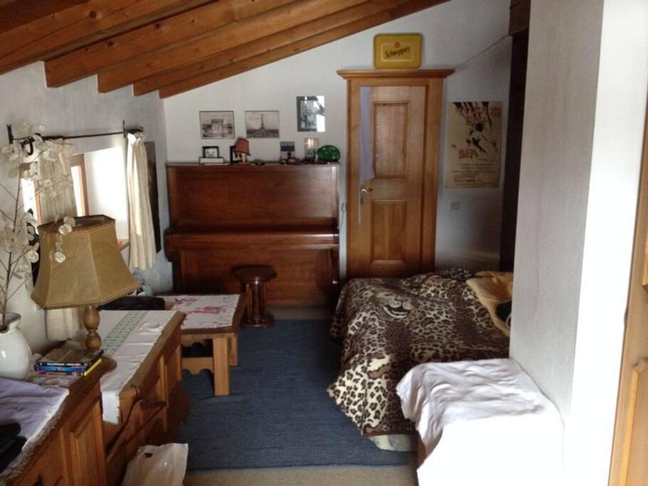cosy attic room with balcony facing south
