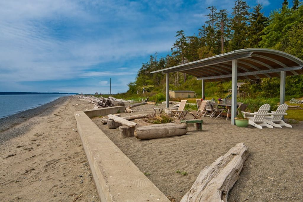 Stroll 155 feet of sandy beach,  and enjoy the large lawn (and lawn toys) and firepit area right at the beach.