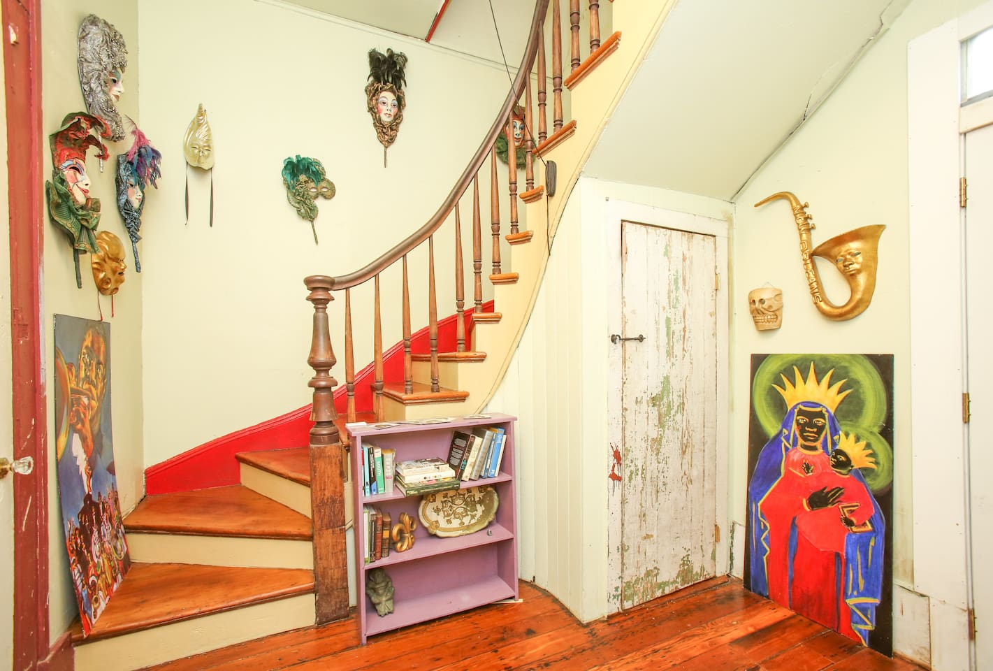 Colorful stairwell filled with local art.