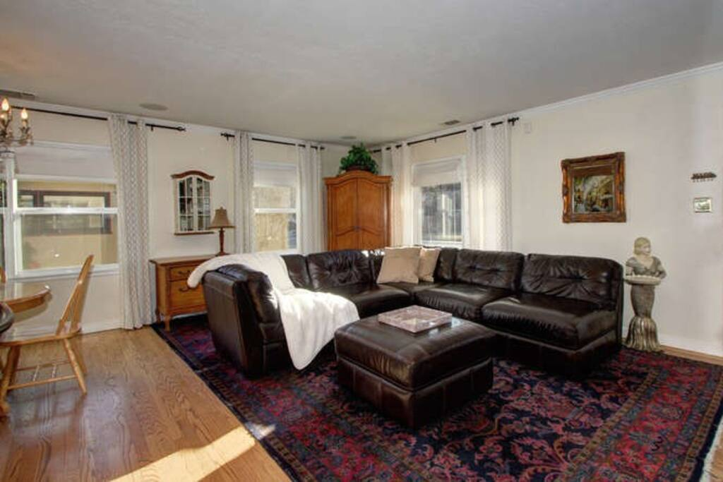 Comfortable leather couch and ottoman