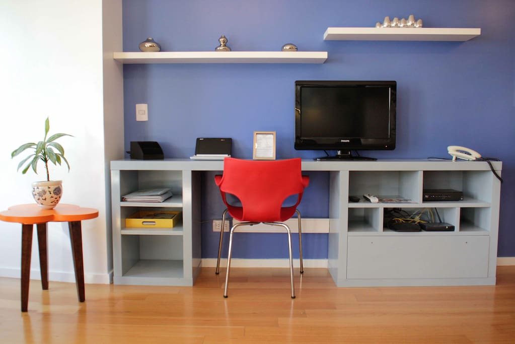 Desk and television area. Direct TV, telephone and high speed wifi internet available.