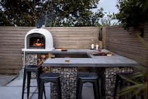 Outdoor Kitchen with huge Pizza Oven and Gas BBQ. Our record for cooking 14 pizzas is 7 minutes!