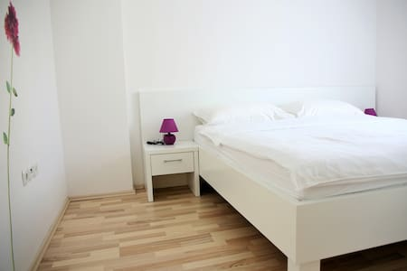 Bedroom with double bed and AC