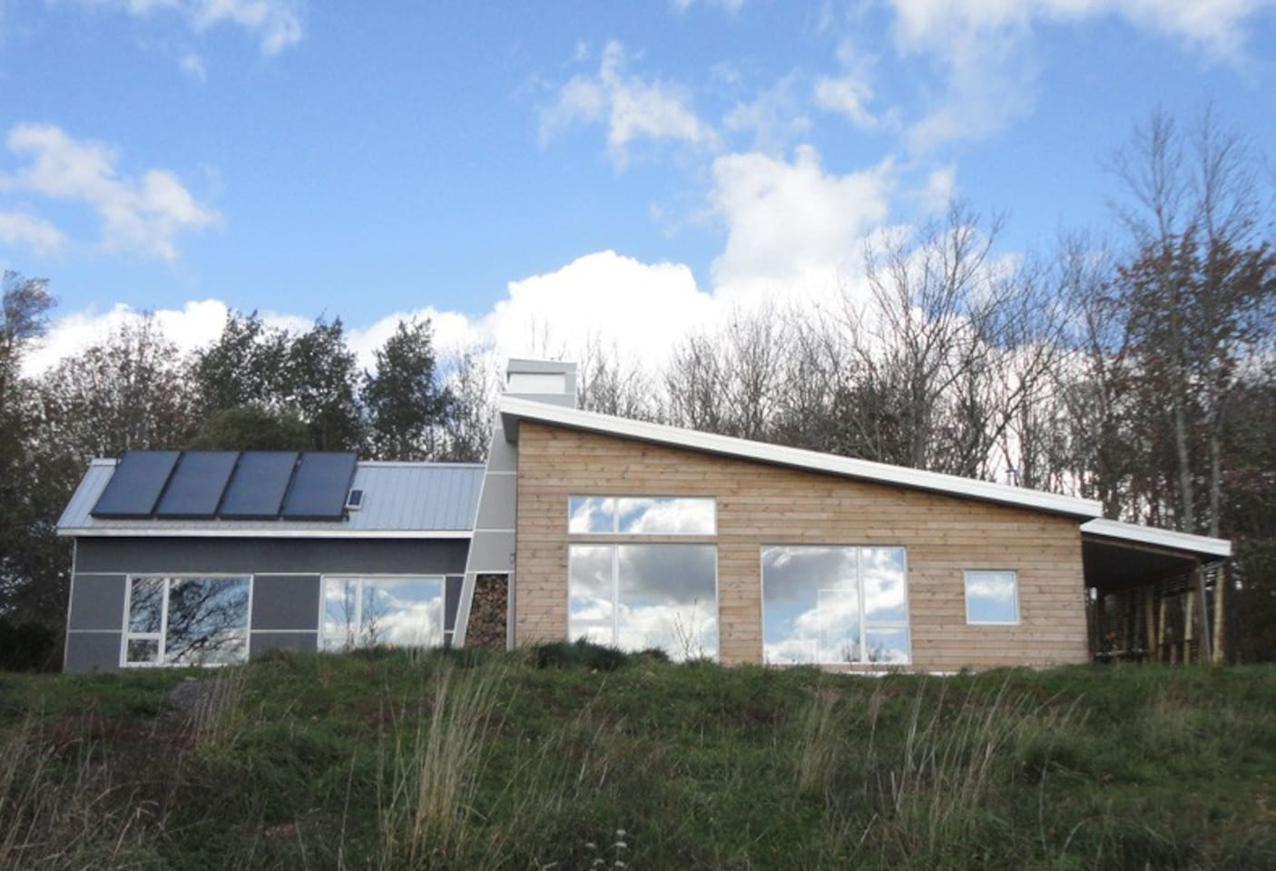 Concept House has a commanding view across the pasture to the inlet.