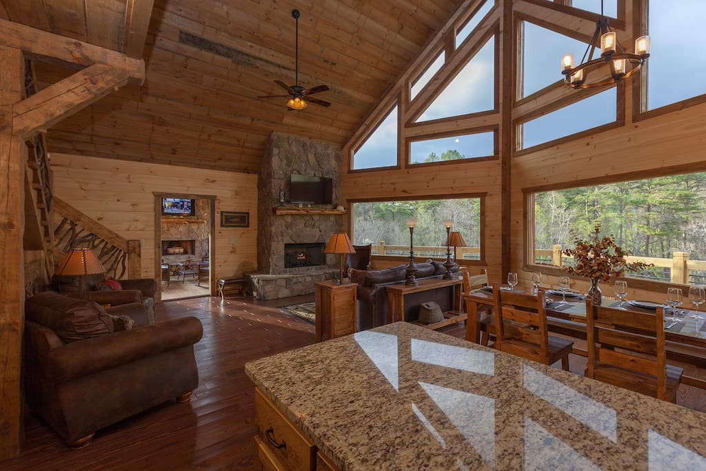 Gorgeous Stone Gas Log Fireplace topped with Large Screen TV