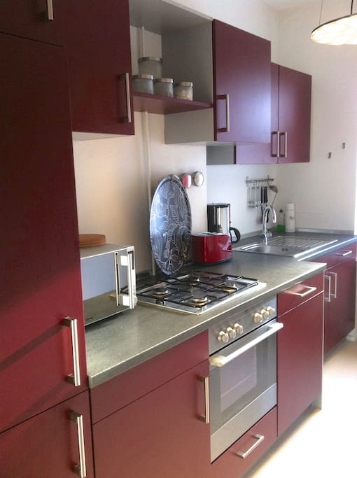 A fully equipped and integrated kitchen with fridge (freezer compartment), gas oven, microwave, dish washer and washing machine. Iron and ironing table available.