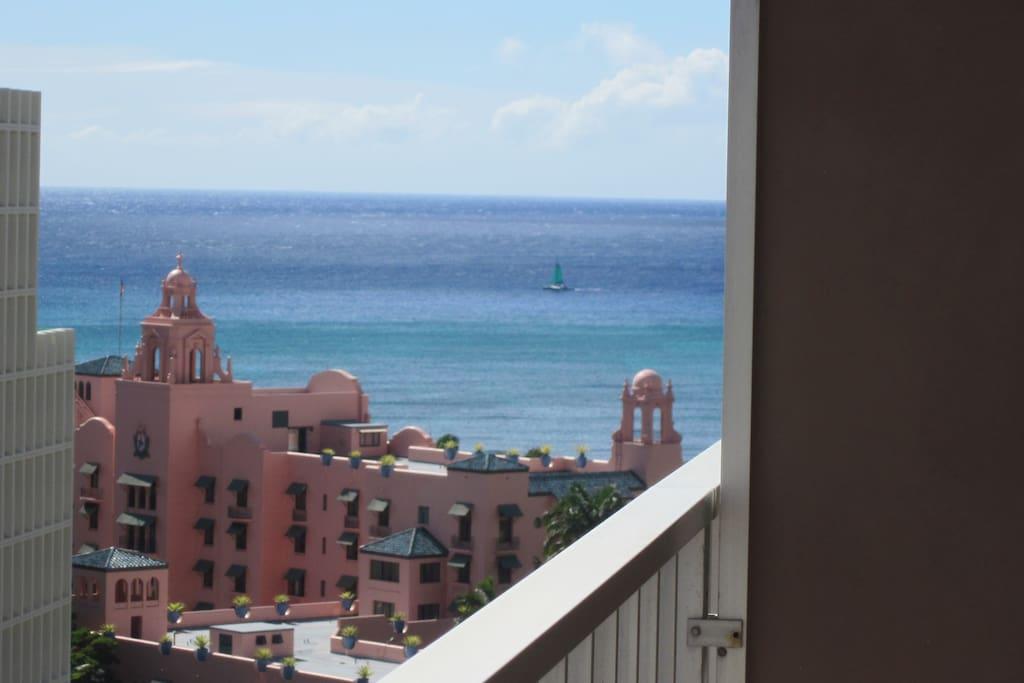 View from your lanai of the Royal Hawaiian Hotel and Waikiki Beach.