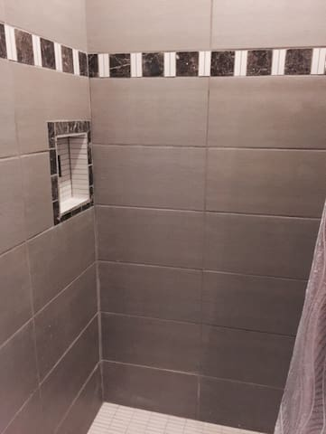 Brand new tile walk in shower.