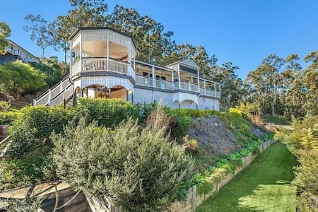 "The ""Old Queenslander"" mansion on a hill - Ev"