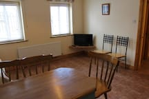 Studio with two single beds and kitchenette with flat screen HD TV