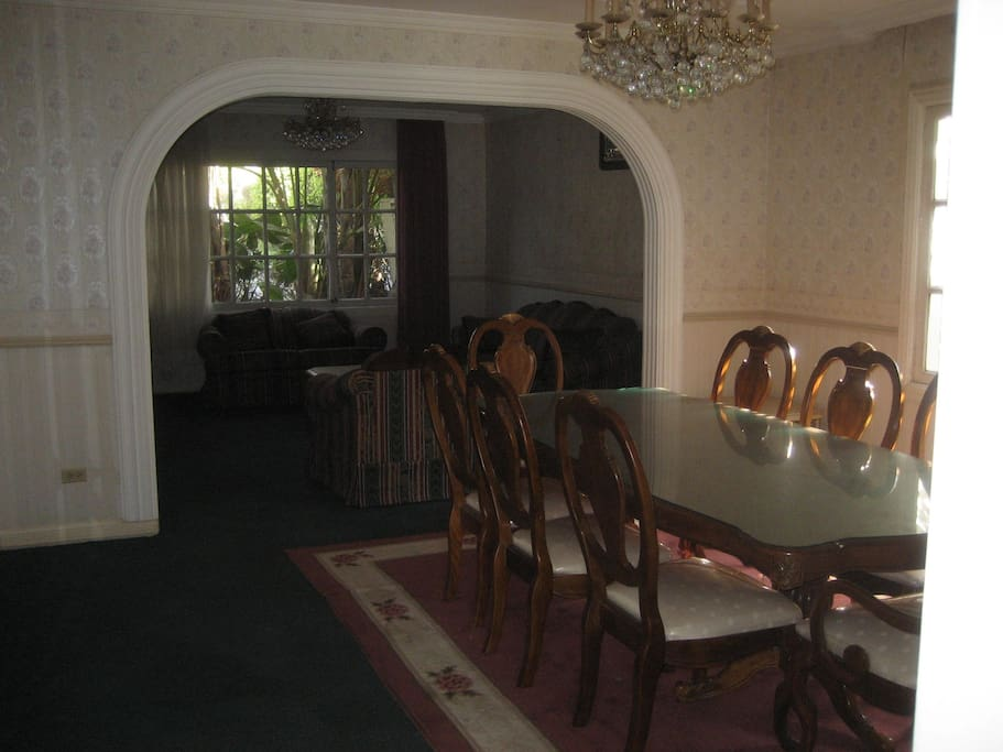 Formal Dining room, sits 8 persons, and secondary living room