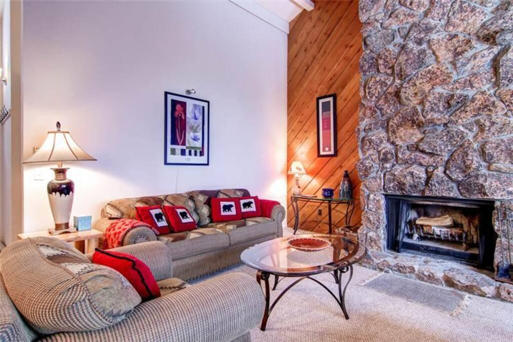 Great upstairs living area with a large wood burning fireplace.