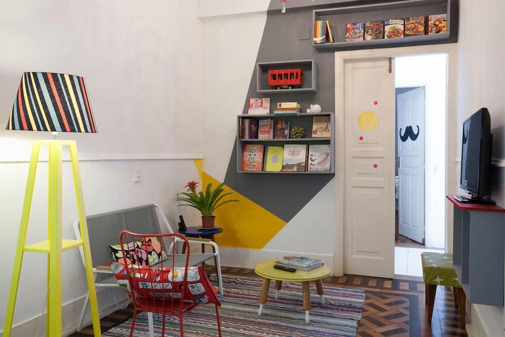 Living room, with one smart tv (The mustache door is of the design office)