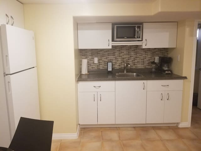 Microwave, toaster oven, and double burner hot plate provided in place of stove.