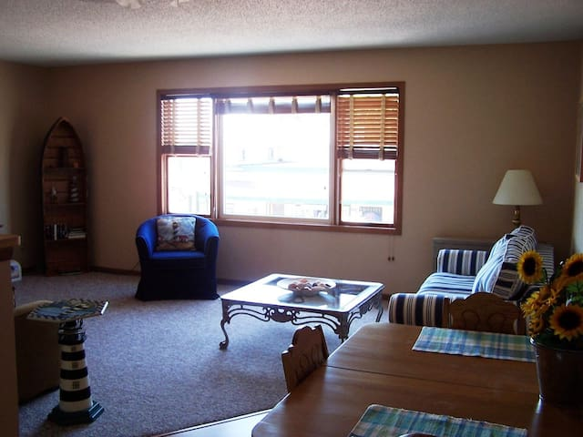 Open living room, dining room and kitchen with a view of the lake 1/2 block away