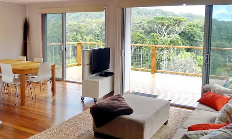 Spacious lounge with 270 degree views across rainforest