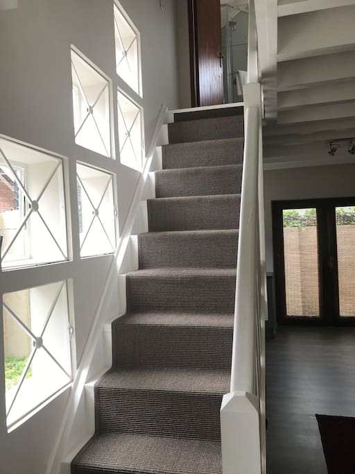 Easy, secure stairway to main bedroom area with full en suite bathroom