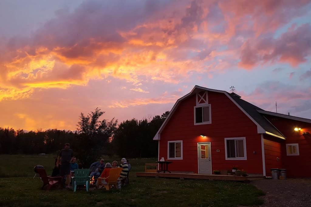 The Hostel at sunset, with guests around the campfire!