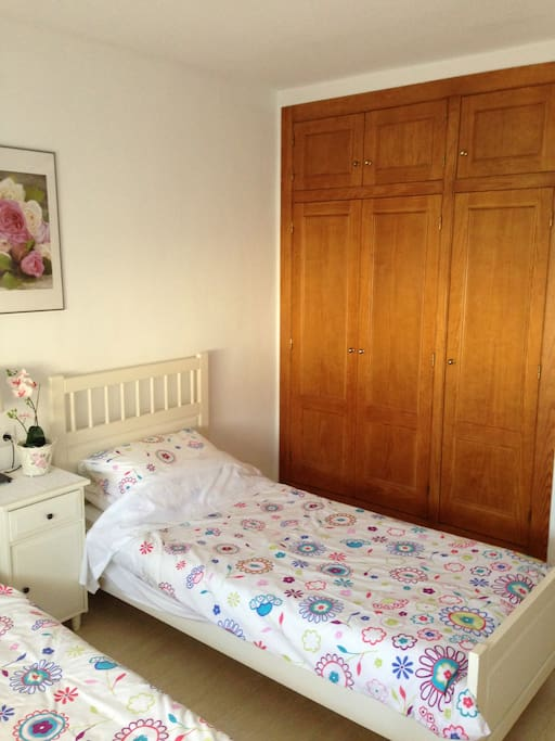 Bedroom 2 with twin beds and large built in wardrobes